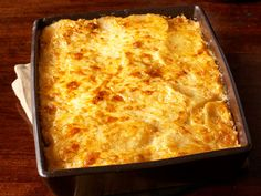 Smoky Scalloped Potatoes recipe from Patrick and Gina...Neely via Food Network add smoked Gouda cheese to replace white cheddar, maybe not use smoked paprika