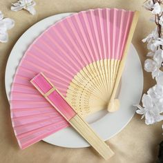 Asian Silk Folding Fans - PINK | eFavorMart / Add a classical Asian touch to your wedding, or a special event by presenting your esteemed guests with this special souvenir. Our stylish silk wedding hand fan is intricately handcrafted with a bamboo structure. The framing and spines are crafted from hand-picked bamboo and durably glued with a seamless cut piece of silk to fashion this immaculate magnum opus. Give these swish fans to your respected guests and let them create the lasting memory…