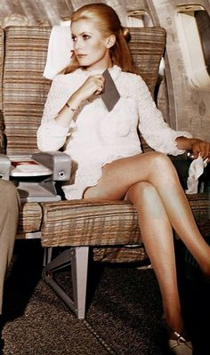Catherine Deneuve enjoying the legroom on a plane in the sixties