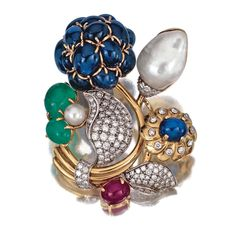 GEM-SET AND DIAMOND BROOCH, SEAMAN SCHEPPS The floral brooch set with sapphires, emeralds and a ruby cut en cabochon, embellished with cultured pearls, one of baroque form, the leaves pavé-set with brilliant-cut diamonds, the stem of yellow gold,