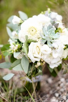 This elegant bouquet was enhanced with succulents and seeded eucalyptus #Breckenridge #Florist #Flowers #Wedding  Florals by Petal & Bean Breckenridge, CO