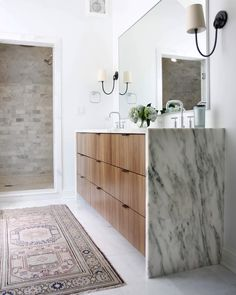 Marble waterfall counter with walnut vanity in modern bathroom by Interior design studio & blog Chicago area Renee DiSanto & Christina Samatas