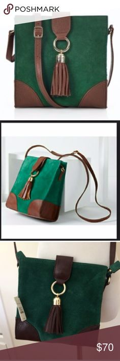 """TALBOTS KELSEY TASSEL SUEDE CROSSBODY BAG New with tags.  The color is forest green suede with brown leather contrast, a sassy tassel and brass colored hardware. Features two inside pockets: one with a zipper and one open pocket.  8"""" L x 7 1/2"""" W x 6"""" D  Smoke free home, ships same day, top-rated seller, top 10% seller Make offer or select """"add to bundle"""" for private, no obligation discount Talbots Bags Crossbody Bags"""