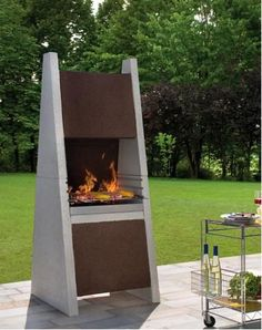 Called 'Tuinhaard' in Dutch, which is translated as garden fireplace, these Palazzetti fireplaces are similar in design and function to Buschbeck masonry barbecue fireplaces. Barbecue Design, Grill Design, Outdoor Fire, Outdoor Living, Outdoor Decor, Parrilla Exterior, Model House Plan, Backyard Fireplace, Property Design