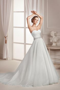 La Sposa - Affezione - Organza A line with sweet heart neckline . Embellished belt covers the waist. Available in Ivory or White.