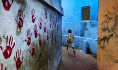 Children running, colourful walls