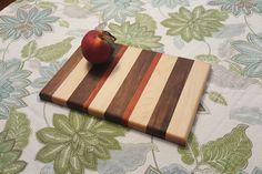 "Handmade out of walnut, maple, and padauk. 11 1/2"" x 7 1/2"" x 1/2"""
