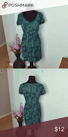 Beautiful Emerald Green Printed Skater Cut Dress In excellent condition. Worn less than three times. Very Flowy and soft. The color is so rich and beautiful that it really stands out! Dresses Midi