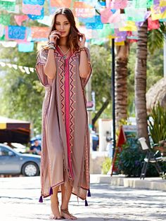 Skemo Embroidered Maxi Poncho at Free People Clothing Boutique