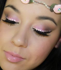 Pretty pink eye shadow enhanced by eye liner of pink crystals.