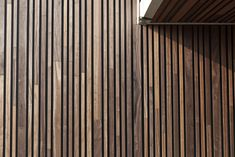 Woodface®:innovative sold timber vertical wall concept(can be totally personalised to suit). The wooden profiles are available in 3 widths and thicknesses. They are fitted using aluminium profiles (anodised/in an RAL colour). Possible to integrate LE