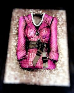 Mary Kay jacket cake by Cake Rhapsody, via Flickr This is Jessica Cawley's cake for her MK director debut!!