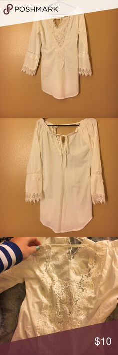 Off the shoulder boho style top White off the shoulder boho styled top. The front has a deep V covered by the lace, so you would be able to see a bra through that but I've worn a white one with it and it looked fine! Tied in the back it's a tunic style so on the longer side. Fabric is slightly see through I posted a picture and you can see my blue nail through it! But again if you wear white you're all set! Slight wear no tears or stains! Tops Tunics