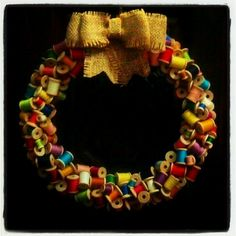 Wreath made of vintage wooden spools with a burlap bow