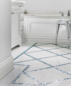 All About Glass Mosaic Tile Iridescent Aquamarine Colored Glass Mosaic Crisscrosses A Marble Bathroom Floor Staying Within Its Own Blue Border To Mimic An Area Rug Designer Interieurs Finnie Ward Marble Bathroom Floor, Marble Floor, Bathroom Flooring, Small Bathroom, Tile Floor, Basement Bathroom, Glass Tile Bathroom, Marble Bathrooms, Remodel Bathroom