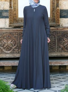 If you love our Easy Care Flared Abaya, you'll love it even more in our fan-favorite lightweight jersey. Nothing says comfort and softness against the skin like our soft jersey fabric. And the elasticized sleeves, front opening, and the perfect flattering, feminine flair work together to create one beautiful, practical piece you'll be reaching for day after day.