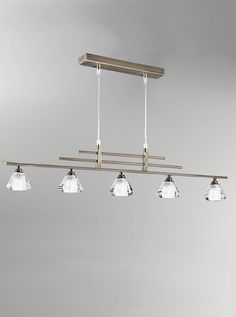 FL2248/5 5 light in-line pendant bronze with crystal glass shades. Bronze finish fitting with small crystal glass shades. Adjustable prior to instillation. Supplied with Osram G9 mains voltage halogen bulbs suitable for dimming. 5 x 33w G9 Lamps included Height- 116cm Minimum Height- 26cm Width- 90cm  BRAND: Franklite REFERENCE- FL2248/5 AVAILABILITY: 3-4 Working Days