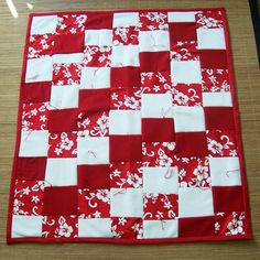 Simple bright squares of cotton and fleece sewn into a pretty baby quilt. Lara Johnson