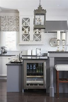 grey island; white cabinets; floors
