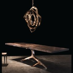 Hudson furniture La Cage dining room table with metallic gold Rose Base and La Cage light.