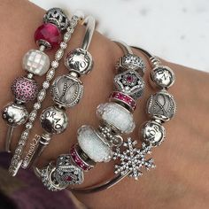 We love this wintry white combo with touches of dark pink! #PANDORATexas #PANDORAbracelets #PANDORAcharms