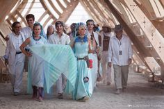 woman-with-blue-cape-at-the-opening-of-the-temple-of-whollyness-burning-man-2013-cargo-cult-black-rock-city-jonathan-clark