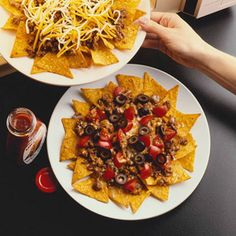Involve the kids in making these taco-flavored beef nachos. Serve as a party appetizer or a main dish./