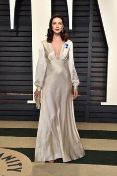 Balfe looks like a colored photo of the 1930's at the Vanity Fair Oscars after party.