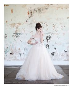 Wedding dress by Inbal Dror, earrings by Kristin Hayes Jewelry, vintage ring from House of Lavande. Photographed at 701 Whaley in Columbia, SC. Featured in the Winter 2015 issue of Weddings Unveiled.