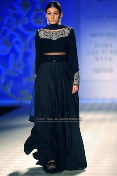 A model walks the ramp for Varun Bahl walks the ramp on Day 3 of India Couture Week, 2014, held at Taj Palace hotel, New Delhi. (BCCL/Ranjit Kumar)