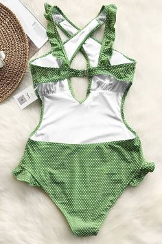 Turn heads in this swimsuit at the hotel pool or beach. Product Code: Details: Cross at front Ruffles design Back hook closure Regular wash Fabric: spandex Reference:model try on SIZE M, height weight 155 lbs, bust SIZE(IN) US BUST LENGTH HIP S M Fun One Piece Swimsuit, Green Swimsuit, Summer Outfits, Cute Outfits, Swimwear Brands, Cute Swimsuits, Monokini, Bathing Suits, Beachwear
