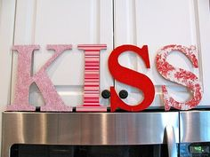 Valentines.  Looks like you could buy the big letters then mod podge different color paper on to them.  Super cute & easy!