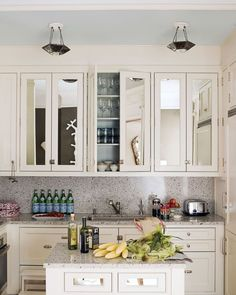 Mirrored kitchen cabinet doors create the illusion of more space. Do mirrors belong in the kitchen or does that just beg for constant cleaning with Windex? Easy Kitchen Updates, Updated Kitchen, New Kitchen, Kitchen Decor, Kitchen Ideas, Kitchen Designs, Kitchen Sink, Island Kitchen, Kitchen Pantry