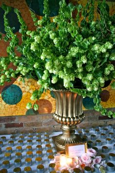 Hops in a vase near the guest book.... Yes! Works with the brewery theme :)
