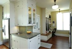 The back corner; mudroom cubbies & built in desk... that's what I want with a larger desk area.