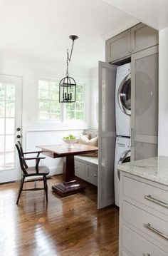 These folks have their washer/dryer in their kitchen too! Great idea for hiding it