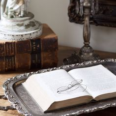 What could be more peaceful than a morning spent reading in this lovely setting? #Antique books and #vintage accents create a beautiful and serene space. How do you style your #home office?