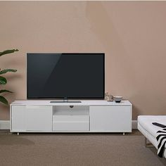 The Carrera TV Stand is available in your choice of a high gloss white or a rich wenge finish. The two storage compartments on the ends and the media drawer in the center have unique, uneven panels that add visual interest. $769.00