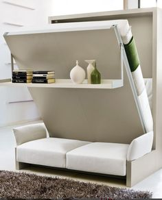 NUOVOLIOLÁ 10 Storage wall with fold-away #bed by CLEI   #design Pierluigi Colombo