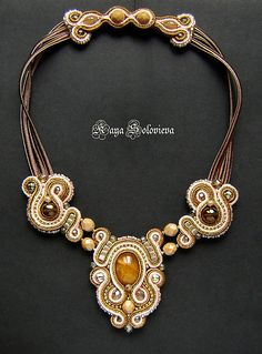 Soutache jewelry though is not widely known yet but emerging artisans like Kaya who sew, embroider and bead these designs are amazing.    She combines the soutache with beads, crystals and gemstones taking full advantage of the soutache to create rather baroque flourishes like scrolls and geometric shapes. Some of her designs are backed with soft leather.