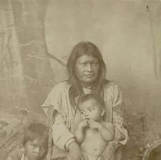 Ih-tedda (a wife of Geronimo) with her daughter Lenna and her son Robert on her lap - Mescalero Apache - circa 1886