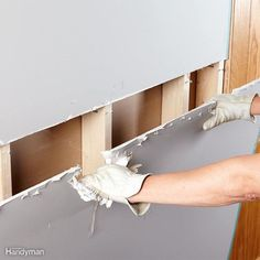 Tearing out drywall can be frustrating because it always seems to crumble into little pieces, and it takes a long time to demo a wall one handful at time. Take a little extra time to find the seams between the sheets, and cut them open with a utility knife. Then bust out a couple of holes for your hands to fit through. Instead of pulling super-hard right away, tug and wiggle the drywall away from the studs until the screw heads break through.