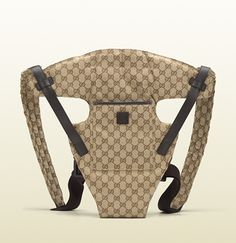 baby carrier with teddy bear and gucci logo leather label.