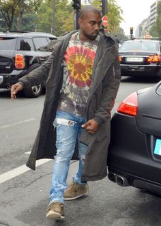 a87bf60b49c50c Kanye West was spotted getting out of his car in Paris late last month. The  rapper wore his custom Levi s 514 jeans with a tie-dye shirt and some  fringed ...