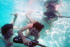 Nirvana pool photos taken by Kirk Weddle in November of 1991, feature Dave Grohl, Krist Novoselic and Kurt Cobain frolicking in a pool and underwater action shots with their instruments.