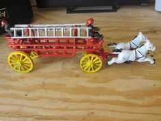 Vintage Cast Iron Horse Drawn Fire Fighter Wagon w/ 2 Hitches