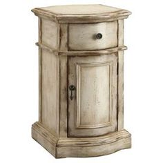 Hand-painted accent chest.Product: Accent chest  Color: Weathered tan  Features:   One door One drawer  Hand-painted  Dimensions: 25 H x 14 W x 18 D