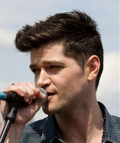 A short brown straight spikey quiff mens Danny O'donaghue hairstyle by Celebrity Hairstyles