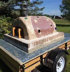 This mobile pizza oven incorporates glass bottles, seashells and ceramic tile for the most interesting Cortile Barile oven we've ever seen!  Somebody excelled in art class!  To see more pictures of this oven (and many more ovens), please visit - BrickWoodOvens.com