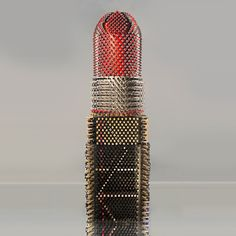 sculpture made from 5000+ lipstick tubes by agne art